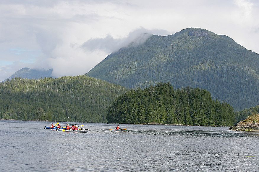Photo: Kayaking under Meares Island's Lone Cone Mountain.